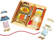 Trä på dockans kläder
